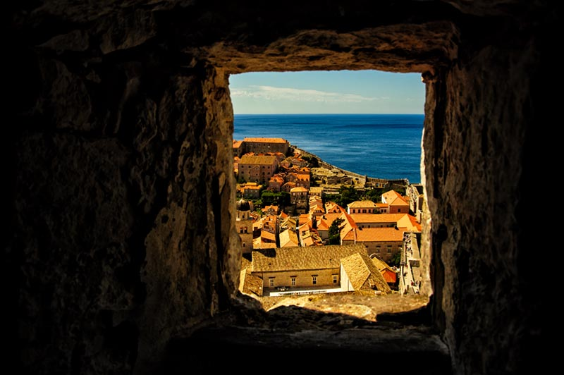 Looking out on the Old City of Dubrovnik through a fort window.